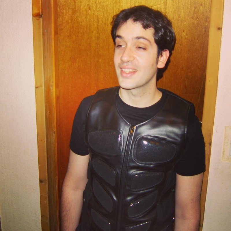 Long, long ago I tried to go through a goth phase. Here's me dressed in a ridiculous vest before going out to the Mission, Edinburgh's premier (and maybe only) goth and rock club.